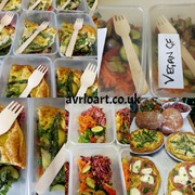 Salads in boxes with bamboo forks